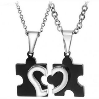 Paire de pendentifs acier puzzle coeur noir et argenté